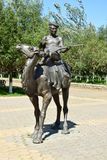 Sculpture featuring a man with a string musical instrument on a camel Royalty Free Stock Photography