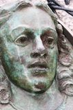 Sculpture of Female face. Detail of a sculpture of a female face in copper stock photography