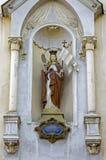 Sculpture of female saint Stock Images