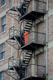 Sculpture on a fire escape Stock Photo