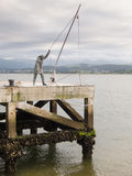 Sculpture of a fisherman Stock Photography