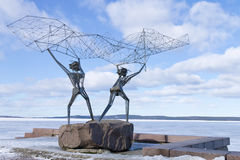 Sculpture Fishermen on the embankment of Lake Onega in Petrozavodsk, Russia Royalty Free Stock Photography