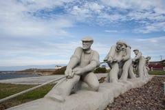 Sculpture of Fishermen. A Sculpture of Fishermen on Iles De La Madeleine royalty free stock photo