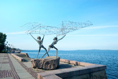 Sculpture The Fishermen in Petrozavodsk, Russia. Sculpture by american sculptor Rafael Consuegra was installed on embankment of Lake Onega in 1991 Royalty Free Stock Images