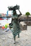 Sculpture `Fisherwoman` by artist Julio Nieto on the Playa del Muelle. PUERTO DE LA CRUZ, SPAIN - JULY 19, 2018: Sculpture `Fisherwoman` by artist Julio Nieto royalty free stock image