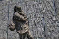 Sculpture, fleeing baby mother Stock Photos