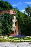 Sculpture in flower garden, Graz. Summer Garden with flowers in Graz, Austria Stock Photos