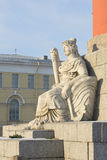 The sculpture at the foot of the southern rostral column. Saint-Petersburg Stock Images