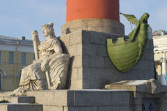 Sculpture at the foot of the southern Rostral column in winter. Saint-Petersburg Stock Photo