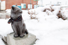 Sculpture of frightened cat on snow Stock Images