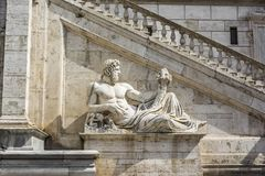 Sculpture in front of stairs of Palazzo Senatorio at Piazza del Campidoglio, Rome, Italy Royalty Free Stock Photo
