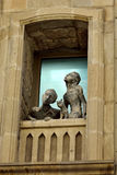 Sculpture of a girl, a boy and a cat looking out of a window in Old Town quarter of Baku. Stock Photography