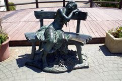 Sculpture of a girl relaxing on a seat at Marbella beach, Andalusia, Spain, Europe Royalty Free Stock Photography