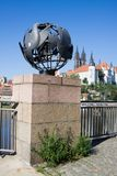The sculpture of the globe with the pigeons. As symbol of world peace in Meissen in Germany. In the background is the Albrechtsburg castle royalty free stock image