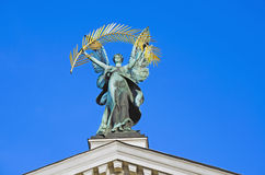 Sculpture of Glory, with a gold palm branch, on the roof of the Opera and Ballet Theatre in Lviv Stock Photography