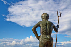 The sculpture of the god Neptune's skyline. Royalty Free Stock Image