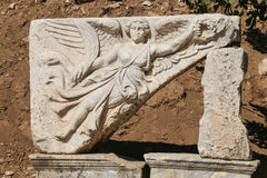 Sculpture of the god Nike in ancient roman city Ephesus, Turkey. Sculpture of the god Nike in the archaeological site of ancient roman city Ephesus, Turkey Stock Images