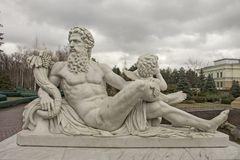 Sculpture of the god Zeus and Cupid. Marble sculpture of Zeus and Cupid, culture of Europe Royalty Free Stock Image