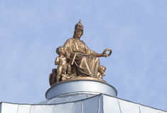The sculpture of the goddess Minerva on top of the dome of the Academy of Arts. St. Petersburg Royalty Free Stock Image