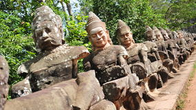 Sculpture of gods outside Angkor Thom city Stock Images