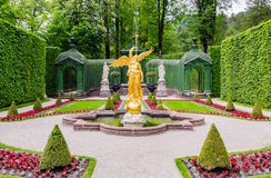 Sculpture of gold angel in the park of Linderhof Palace, Bavaria. ETTAL, GERMANY - JUNE 5, 2016: Sculpture of gold angel in the park of Linderhof Palace, Bavaria Royalty Free Stock Photo