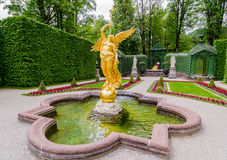 Sculpture of gold angel in the park of Linderhof Palace, Bavaria. ETTAL, GERMANY - JUNE 5, 2016: Sculpture of gold angel in the park of Linderhof Palace, Bavaria Stock Photography