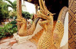 Sculpture of golden dragons at the entrance of a traditional Thai temple Royalty Free Stock Images