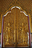 The Sculpture Golden Wood Doors. The Doors are the design of male bird with a human head Stock Image