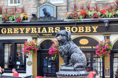 Sculpture of Greyfriars Bobby. In front of a pub - a Skye Terrier who in the 19th century guarded the grave of his owner for 14 years Royalty Free Stock Photos