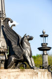 Sculpture of griffin on stone pedestal Stock Photography