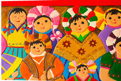 Sculpture of a group of colorful mexican women on the wall.  Stock Image
