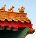 Sculpture on guardian on roof of Chinese Shrine Stock Images