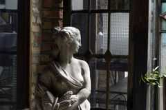 Sculpture in half-naked woman`s plaster royalty free stock photography