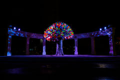 Sculpture Happiness Tree. Tyumen, Russia - September 13, 2016. Sculpture Happiness Tree. Beautiful night view of the colorful leaves of the tree backlit Stock Photo
