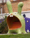 Sculpture hare. Fun and funny sculpture eared rabbit Stock Image