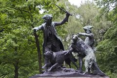 Sculpture of hare hunting party Stock Photos
