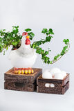 Sculpture of hen near  bio eggs in box Royalty Free Stock Photography