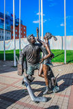 Sculpture of a hockey player and a woman Royalty Free Stock Images