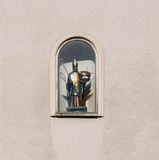 Sculpture of holy St Nicholas on a house wall in Regensburg, Germany.  Stock Image