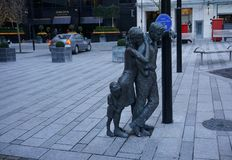 My Shoulder, `When You Are Down`. Sculpture of hope and dependability, being there when though times sets in royalty free stock photo
