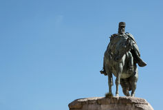 Sculpture of a horseman with blue sky background Stock Photography