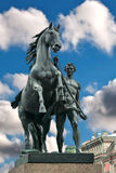 Sculpture horseman with a horse. Royalty Free Stock Images