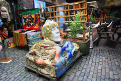 A sculpture of human head decorated with mosaic. At Camden Market, London, Great Britain Stock Images