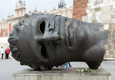 Sculpture by Igor Mitoraj Eros Bendato on the Main Square in Cracow. Stock Image