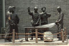 Sculpture with image of ancient chinese people in Stock Photo