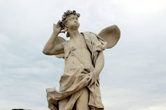Sculpture of an important cupid. In the gardens of St. Petersburg royalty free stock photography
