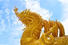 Sculpture In Thai(The Golden Naga) Stock Photo