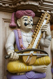 Sculpture of an Indian Musician. A sculpture of a an Indian Musician. I'm unsure of the instrument.  It could be a sitar, though this often plucked. Esraj and Royalty Free Stock Photography