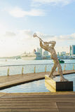 Sculpture of Jazz Player and Singapore Cruise Center at Harborfr Royalty Free Stock Images