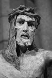 Sculpture of Jesus Christ. White stone sculpture of Jesus Christ with crown of thorns during crucifixion Stock Images